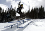 Picnic tables aren't for eating at Echo Mountain Park as Jason Kaplan (cq) 21 from Evergreen, CO ...