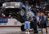(Denver, Colo., July 11, 2004) Judges watch as a car operated by switchman Marco Lujan hops in the...