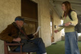Grace Burgwyn, right, talks with Richard A. Collins on Collins' front porch in Denver Thursday,...