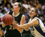 Laine Baity, right, reaches in on Kari Beth Faber, left, of Pagosa Springs, as Faber goes up for ...