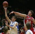 Nate Soldier, right, of Buena Vista tries to block a shot by Brent Schuster, of Denver Christian,...