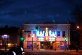 Despite new businesses and condo developments, the Bluebird Theater, flanked by an adult...