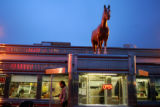 A customer leaves Davies'  Chuckwagon Diner in the pre-dawn hours on Wednesday, March 8, 2006. ...