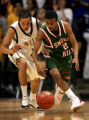 Mullen's Devin Aguillar (#3, in white) fights for a loose ball with Smoky Hill's Will Figures (#2,...