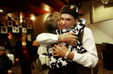 Virginia Kirchmaier, cq, sister of Steven R. Nickerson hug after a presentation by Eugene Richards...