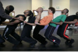 On March 20, 2006, Cleo Parker Robinson (cq) (fourth from the left) hops into dance rehearsal for...
