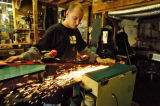 Jack Pallett (cq) sharpens a ski Thursday afternoon March 22, 2006 at Edge Works in Denver, at 860...