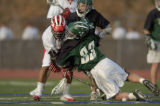 Denver East High School's Josh Russell, left, collides with Fort Collins High School's Alex...