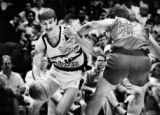 Clippers center Greg Kite hooks Nuggets forward Bill Hanzlik as Hanzlik drives for the basket. ...