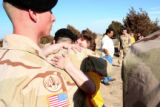 Vicki Bosley, cq, facing, hugs soldiers who served with her son  SSG Justin Vasquez, who was...