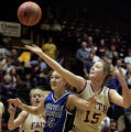 Denver Christian guard Robin Van Deren, left, tries to box out Faith Christian post player...