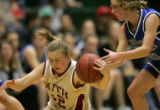 Faith Christian guard Amber Roundtree, left, steals the ball from Denver Christian guard Lindsay...