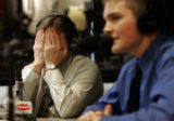 Sean Allen's father, Jeff Allen, covers his face with his hands while he listens to Jay Bennish's...