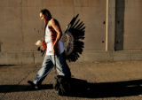 Cetan ThunderHawk (cq), 29, a traditional Native American dancer, leaves the Denver Coliseum...