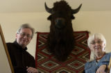 **FOR SPOTLIGHT Michael and Kathy McCoy pose by an antique bison head in their home in Buena...
