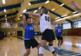 Sandy Roudebush(cq), 10, looks to pass the ball, while Joy Kaylor(cq), 55 blocks during a...