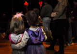 Maylu Souter-Perrot(cq), right, hugs Zo' Cachion(cq) during the second monthly Baby Loves Disco...