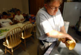 (LITTLETON, CO. JULY 26, 2004) New Life Episcopal Church Reverend Chuck Reischman, washes the...