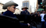 Jack A. Weil, founder of Rockmount Ranchwear, sits in the back of a horse drawn buggy Tuesday Mar....