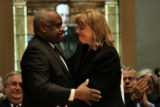 U.S. Supreme Court Justice Clarence Thomas gives soon-to-be-sworn-in Allison H. Eid a hug after...