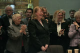 With family and friends applauding behind her, Allison H. Eid smiles after being sworn in. In...