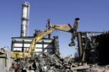 Workers at Sand Creek Energy in Commerce City, (owned by Denver-based Rentech)  tear down a...