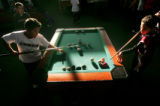 Guillermo Cruz (cq),7, left, squares off with Gabe Morales (cq), 10, right, in a game of bumper...