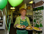 Mary Walsh (cq), of Jus Cookin's Restaurant, delivers lunch Wednesday afternoon March 15, 2006 in...