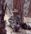 Ed Dentry photo 3/29/06 A hunter relaxes against an ancient ponderosa pine in a previous spring...