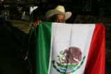Jesus Contreras, (cq) 78, holds the largest of the Mexican flags sold in his nieces store Discos...