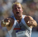 (SATURDAY, July 10, 2004 in SACRAMENTO) Adam Nelson reacts to his fifth-round shot put throw of 71...