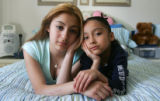 Portrait of Kenia Venzor (cq), 13, left, and Celine Venzor (cq), 7, who were wounded in a drive-by...