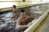 Inmates Daniel Gutierrez (CQ), 26, and Jose Tovar (CQ), 21, clean the fish hatcheries at the East...