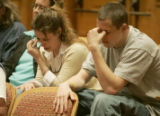 (L-R) Shanna Ortiz (cq) , and Nick Foley (cq) cousins of murdered Mathew Foley cry as their...