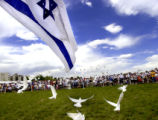 Denver, Colo., photo taken May 9, 2004- Members of the Denver Jewish community gather a watch as...