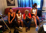 (DENVER, Colo., July 12, 2004) Esperanza Gonzales (third from left), the sister to the slain Frank...