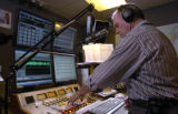 Dennis Harrington (cq), a DJ for Jones Radio Network, checks his sound levels during a broadcast...