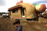 Max Kennedy, 9 of Morrison, takes a last look at the Coney Island hot-dog stand in Conifer Friday,...