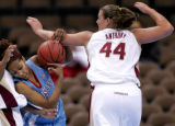 Louisiana Tech's Shan Moore, left, gets tangled up by Florida State's Nikki Anthony,right, in the...