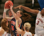 Pepperdine's Kelsey Ball, left, pulls down a rebound being swarmed by  Oklahoma players (left to...