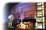 Workers inspect a projection of downtown Denver on the side of the Pepsi Center night.  The $180...
