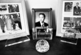 A portrait of Vinh's son stands among crystal awards and photographs of award ceremonies in his...