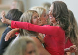 Tiffany Matthews, left, (cq), 22, and Jamela Urbanh (cq), 21, both from Denver, embrace after...