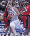 Stanford's  Kristen Newlin, middle, drives past Southeast Missouri State's, Joiceline Thesing,...