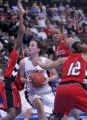 Stanford's Jillian Harmon, middle, is swarmed by Southeast Missouri State defenders (left to...