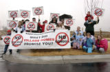 Residents of a development built by Village Homes picket Idyllwide, another Village Homes...