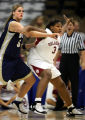 Oklahoma's Courtney Paris (#3) looks to get position down low on BYU's Lauren Riley (#52) during...
