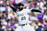 Colorado Rockies reliever Jose Mesa (#49) pitches against the Arizona Diamondbacks during their...