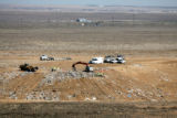 Denver police  search Tuesday Apr. 4, 2006 at the Buffalo Ridge landfill, Keenseburg, Colorado for...