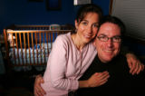Portrait of adoptive parents in the bedroom of their son in Denver on Tuesday, April 4, 2006....